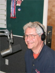 John O'Rourke of Handyman Hotline with headphones and microphone